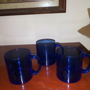 3 small blue drinking glasses